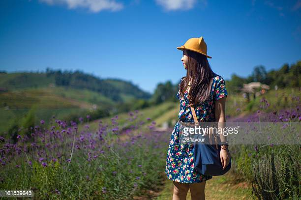Girl with violet flower ( purpletop vervain )