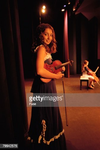 Girl with Violin Waiting to Go on Stage
