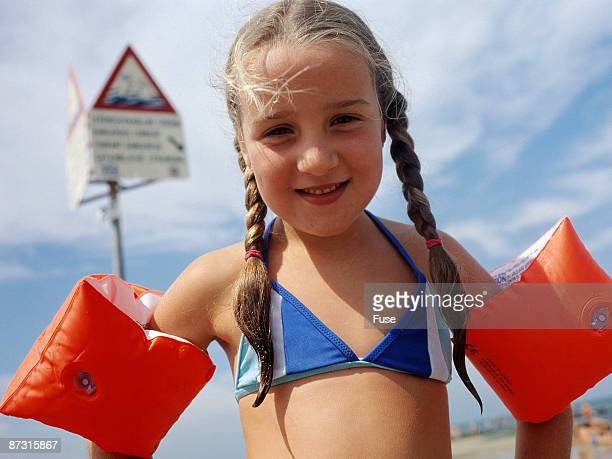 Girl with water wings