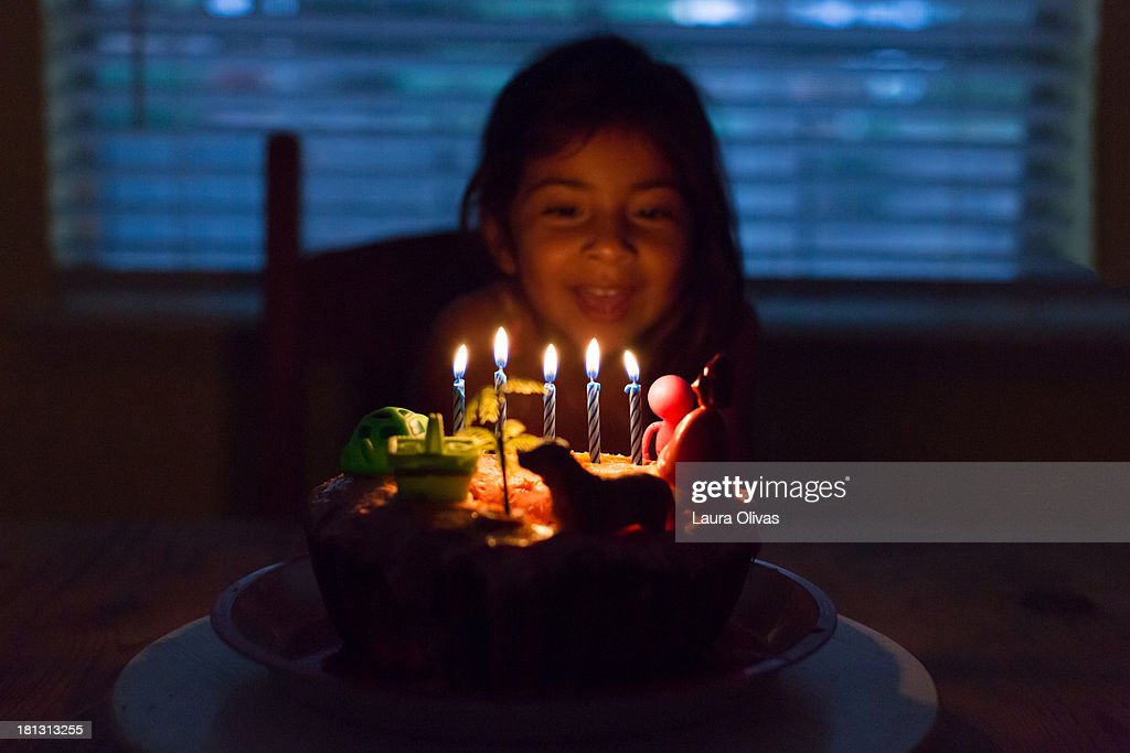 Girl with wildly decorated birthday cake : Stock Photo