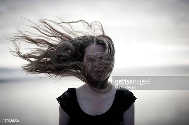 Girl with wind swept hair on beach