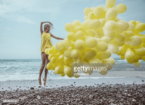 girl with yellow balloons : Stock Photo