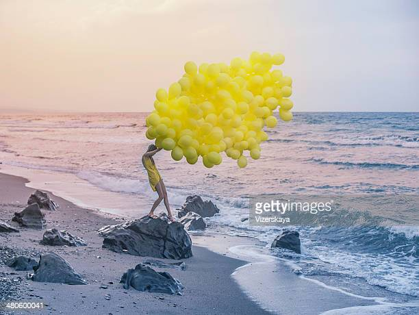 girl with yellow balloons