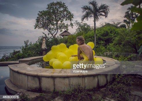 girl with yellow balloons : Stock Photo