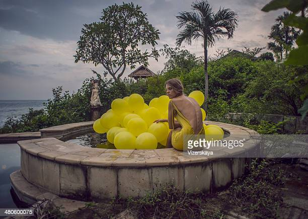 girl with yellow balloons