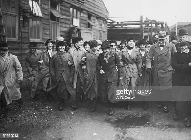Girl workers escort Minister of Munitions Winston Churchill through the yards during his visit to the north 8th October 1918