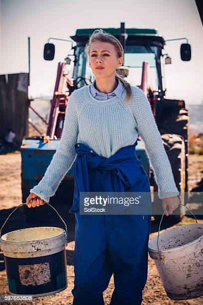 Girl Working Hard on the Farm