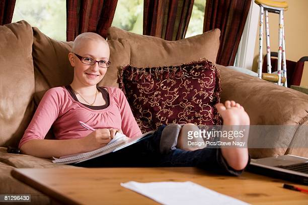Girl working on couch
