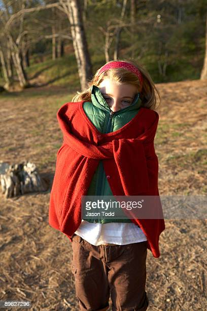 girl wrapped up in jackets