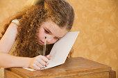 Girl writing a greetings card