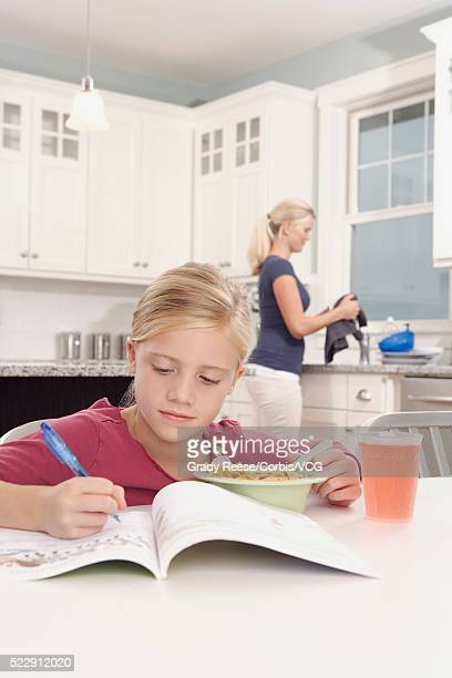 Girl writing in workbook