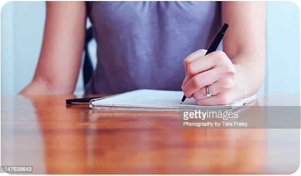 Girl writing with her left hand
