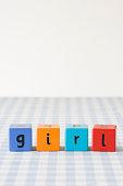 Girl written on building blocks