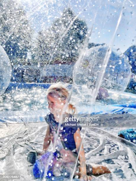 Girl Zorbing In Swimming Pool