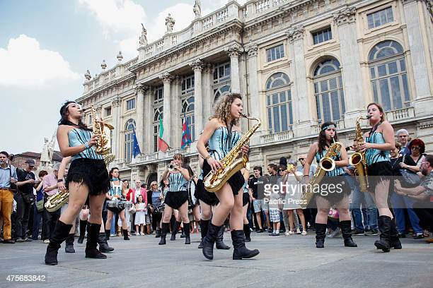 Girlesque the first and only Italian street band of women played and danced parading through the streets of the downtown during the final day of the...
