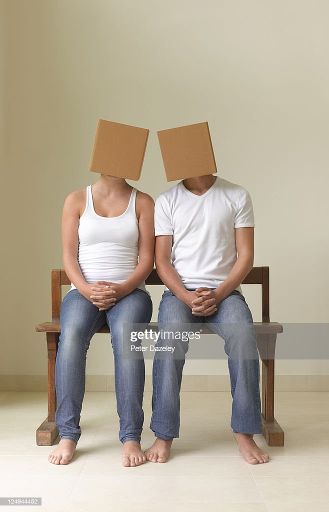 Girlfriend and boyfriend with boxes on heads : Stock Photo
