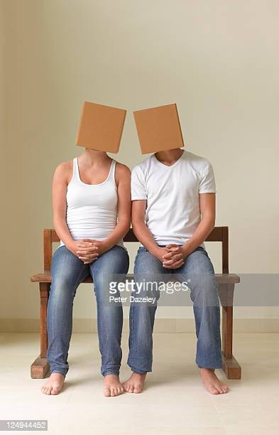 Girlfriend and boyfriend with boxes on heads