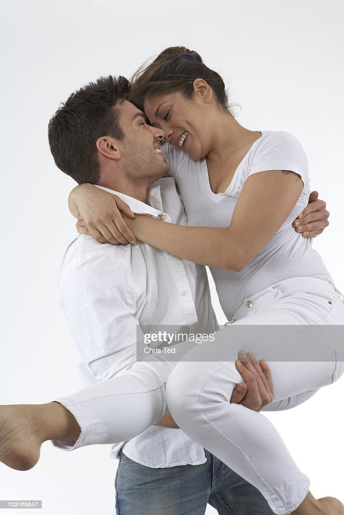 Girlfriend being swept off her feet  : Stock Photo
