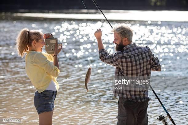 Girlfriend Filming a Boyfriend  Catching Fish