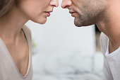 Cropped image of Heterosexual couple going to kiss in bedroom