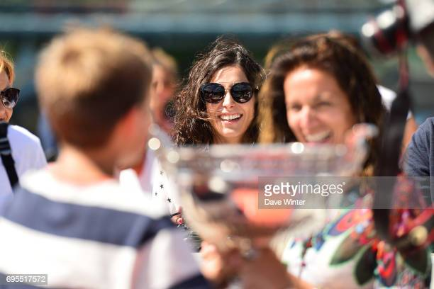 Girlfriend of Rafael Nadal Xisca Perello watches as his friends and family pose with the trophy during the photocall to celebrate his record breaking...