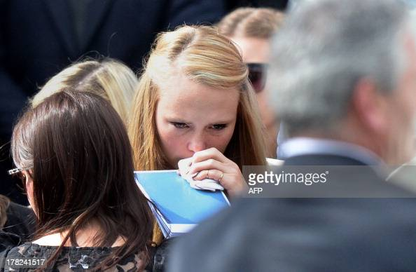 Girlfriend Sarah Harper mourns with family members of Australian baseball player Chris Lane who was killed in the small Oklahoma town of Duncan in...