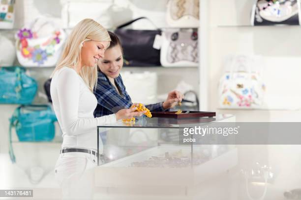 girlfriends are buying fashion accessories bracelets, necklaces in departmant store