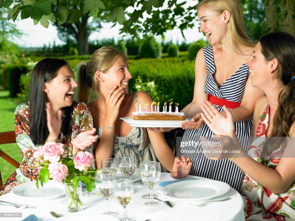 Girlfriends celebrating a birthday : Stock Photo