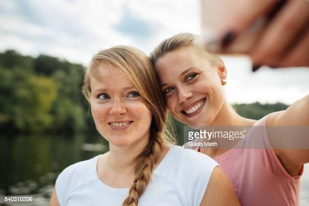 Girlfriends doing selfie.