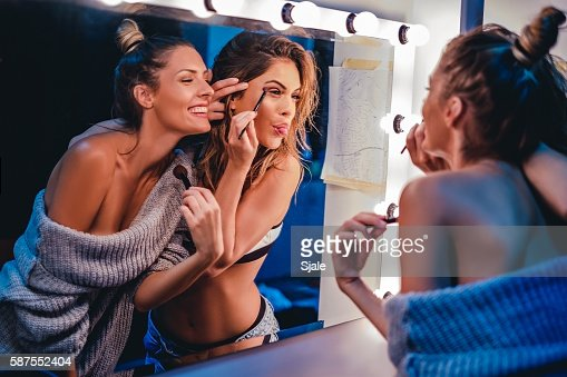 Girlfriends fooling around with makeup : Stock Photo