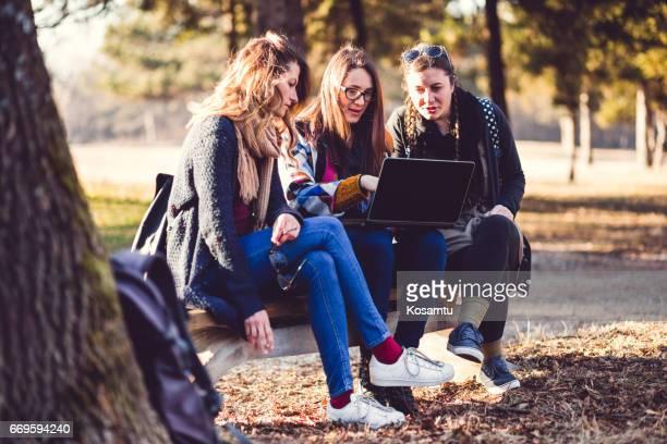 Girlfriends Hanging Around At Park