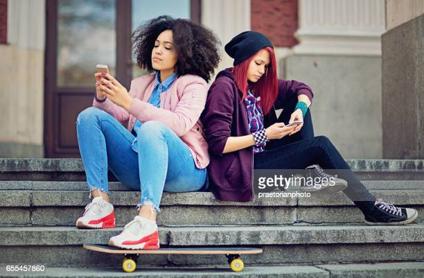 Girlfriends in conflict are texting sulking each other