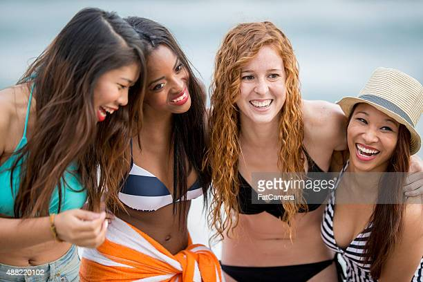 Girlfriends Laughing Together at the Beach