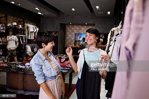 Girlfriends laughing together, while shopping