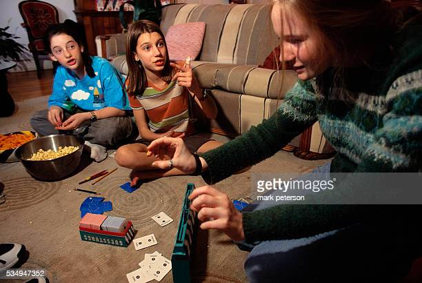 Girlfriends Playing Card Game During Slumber Party