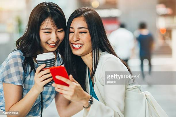 Girlfriends sharing phone content