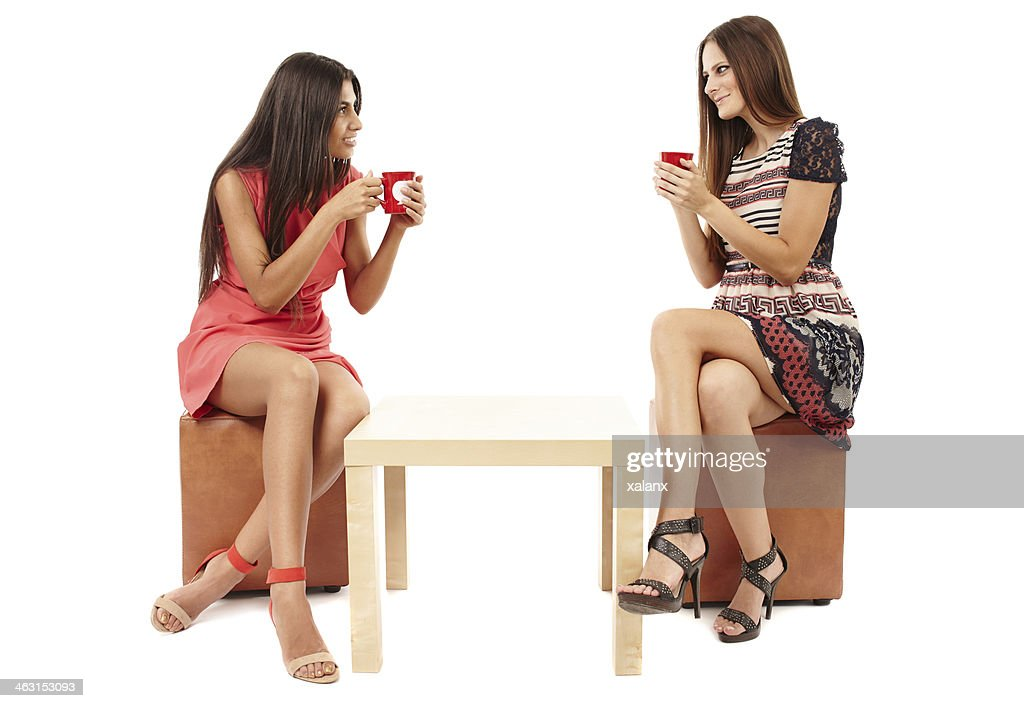Girlfriends Sitting At The Table And Talking : Stock Photo