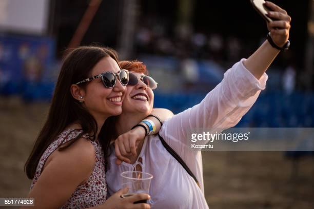 Girlfriends Taking Selfie At Concert