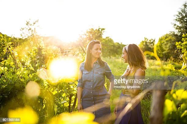 Girlfriends talking in the vineyard