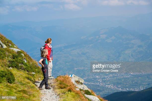 Girls admiring the view in mountains