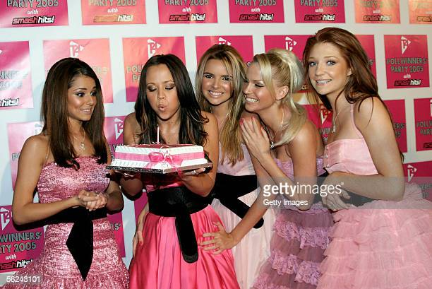 Girls Aloud Cheryl Tweedy Kimberley Walsh Nadine Coyle Sarah Harding and Nicola Roberts pose with a birthday cake for Kinberley in the press room at...