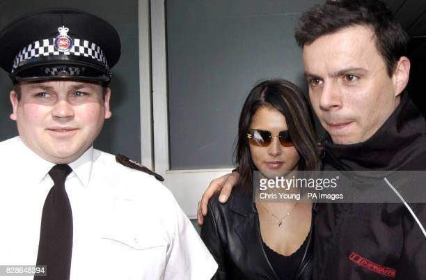 Girls Aloud star Cheryl Tweedy leaves South West Surrey Magistrates Court in Guildford where she appeared charged with racially aggravated assault...