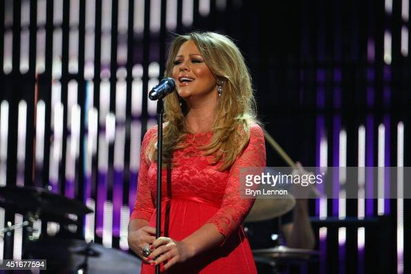 Girls Aloud star Kimberley Walsh sings during the 2014 Tour de France Team Presentation prior to the 2014 Le Tour de France Grand Depart on July 3...