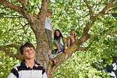 Girls and boy in tree