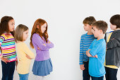 Girls and boys confronting each other
