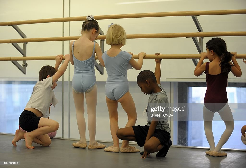 Girls and boys practice as about 100 six-year-olds audition for spots in the School of American Ballet April 5, 2013 at Lincoln Center in New York.The audition is part of the spring recruiting season for new students. AFP PHOTO/Stan HONDA