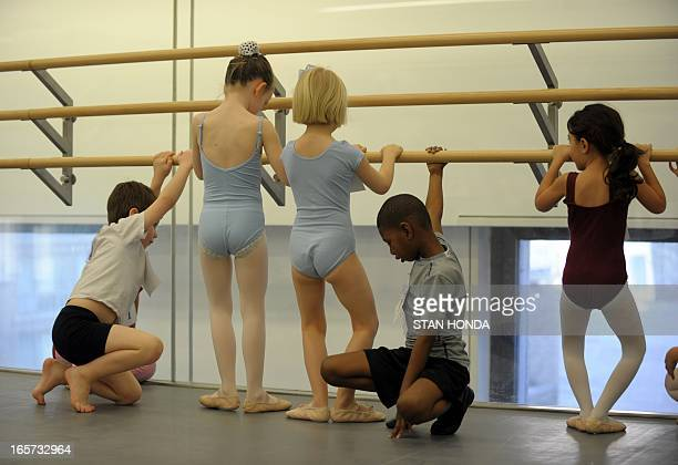 Girls and boys practice as about 100 sixyearolds audition for spots in the School of American Ballet April 5 2013 at Lincoln Center in New YorkThe...