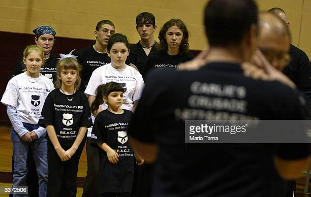 Girls and boys watch selfdefense tactics during a Carlie's Crusade REACT class in defense tactics primarily for girls April 14 2004 in Cornwall New...