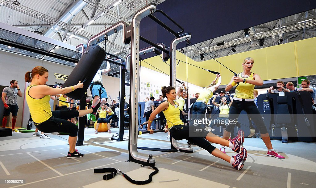 Girls are seen during a circle training session during the FIBO 2013 on April 14, 2013 in Cologne, Germany.