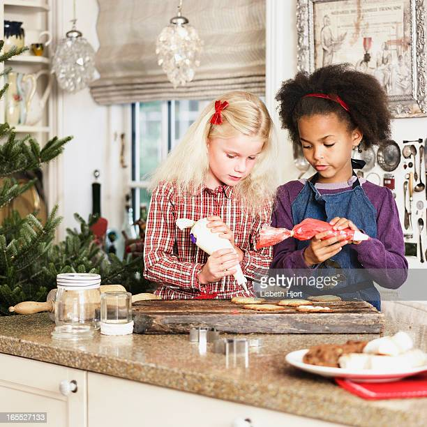 Girls baking Christmas cookies together